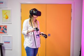 A person wearing a VR headset and holding controllers
